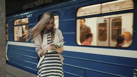 Subway woman on public transport. Tourist using tablet to find . Portrait of happy train coming girl student lady after. Portrait of happy lady with tablet stock video