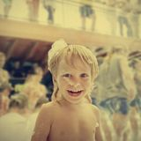 Laughing boy in foam. Portrait of happy laughing boy on foam party during summer vacation. image with warm vintage toning Royalty Free Stock Photos