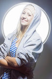 Portrait of Happy and Laughing Caucasian Blond Woman in Warm Hat Royalty Free Stock Photo