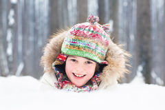 Portrait of a happy laughing child playing in the snow Royalty Free Stock Photos
