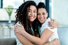 Portrait of happy lesbian couple embracing each other and smiling Royalty Free Stock Image
