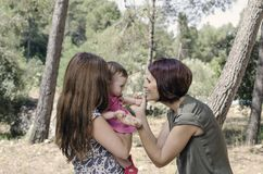 Portrait of happy lesbians mothers with a baby.  Homosexual fami Royalty Free Stock Photos