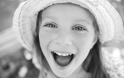 Portrait of a happy liitle girl Stock Images