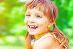 Portrait of a happy liitle girl Stock Photo
