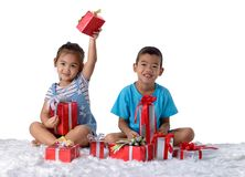 Portrait of happy little asian boy and girl with Many gift boxes royalty free stock image