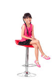 Portrait of happy little asian girl sitting on high chair Stock Image