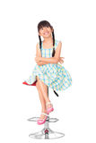 Portrait of happy little asian girl sitting on high chair Royalty Free Stock Photos