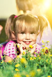 Portrait of happy little baby girl on the meadow Stock Photo