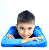 Portrait of happy little boy. Laughing little boy laying on floor Stock Photos