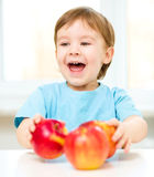 Portrait of a happy little boy with apples Royalty Free Stock Photos