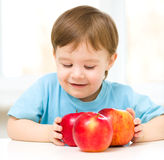 Portrait of a happy little boy with apples Royalty Free Stock Image