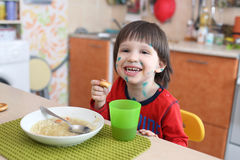Portrait of happy little boy with chicken pox eats soup Stock Photography