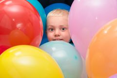 Portrait of happy little boy with colored balloons. stock photo