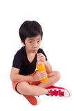 Portrait of happy little boy drinking orange juice. Isolated ove Stock Images