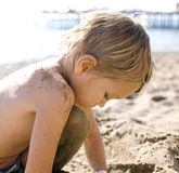 Portrait of happy Little boy enjoying on beach with sand. Close up Royalty Free Stock Images