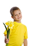 Portrait of happy little boy with flowers Royalty Free Stock Photography