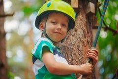 Portrait of happy little boy having fun in adventure park smiling Royalty Free Stock Photo