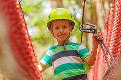 Portrait of happy little boy having fun in adventure park smiling Stock Photo