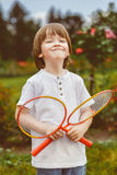Portrait of happy little boy holding badminton Royalty Free Stock Image