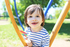 Portrait of happy little boy with lolly in summer Stock Images
