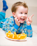 Portrait of a happy little boy. With orange Stock Photography