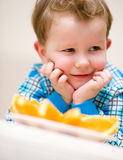 Portrait of a happy little boy. With orange Stock Images