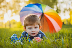 Portrait of a happy little boy in the park Stock Images