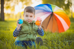 Portrait of a happy little boy in the park Stock Photos