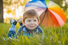 Portrait of a happy little boy in the park Royalty Free Stock Image