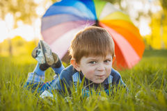 Portrait of a happy little boy in the park Stock Photo