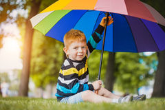 Portrait of a happy little boy in the park Royalty Free Stock Photos