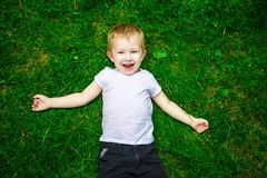 Portrait of a happy little boy in the park Royalty Free Stock Photo