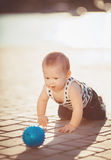 Portrait of happy little boy playing outdoors at dock near the sea Royalty Free Stock Images