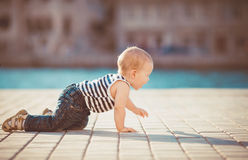 Portrait of happy little boy playing outdoors at dock near the sea Stock Images