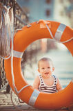 Portrait of happy little boy playing outdoors at dock near the sea Royalty Free Stock Photo