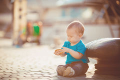 Portrait of happy little boy playing outdoors at dock near the sea Stock Photography