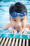 Portrait of happy little boy playing in the pool Stock Images