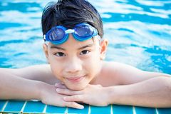 Portrait of happy little boy playing in the pool Royalty Free Stock Photography