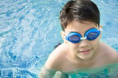 Portrait of happy little boy playing in the pool Royalty Free Stock Photo