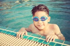 Portrait of happy little boy playing in the pool Royalty Free Stock Photos