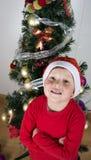 Portrait of happy little boy in Santa hat. Portrait of happy little boy in Santa hat near Christmas tree Royalty Free Stock Photo