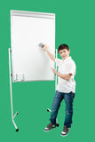 Portrait of happy little boy showing white blank board Stock Images