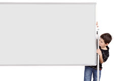 Portrait of happy little boy with white blank board Royalty Free Stock Image