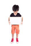 Portrait of happy little boy with white blank Stock Image