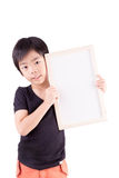 Portrait of happy little boy with white blank Stock Photo