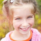 Portrait of a happy little cute girl Royalty Free Stock Photo