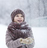 Portrait of a happy little girl on the background of a winter pa Stock Photo
