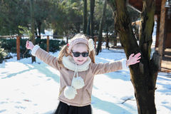 Portrait of a happy little girl on the background of a winter park Royalty Free Stock Photos