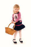 Portrait of happy little girl with basket Stock Images