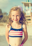 Portrait of happy little girl on the beach. Stock Photo
